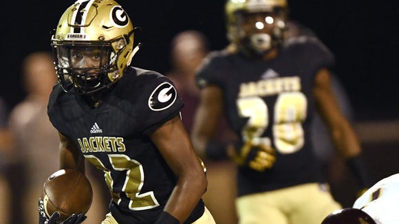 Greer's Dre Williams (22) rushed for 1,766 yards with 14 touchdowns as a junior and helped the Yellow Jackets reach the Class AAAA Upper State final.