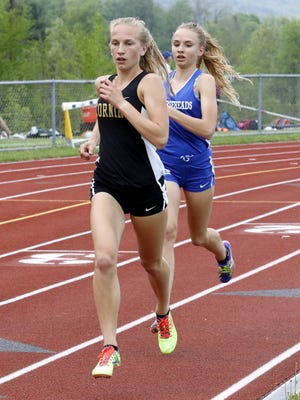 Jessica Lawson of Corning leads Madison Klein of Horseheads in the girls 1,500 meters Thursday at the STAC championship meet at Windsor High School.