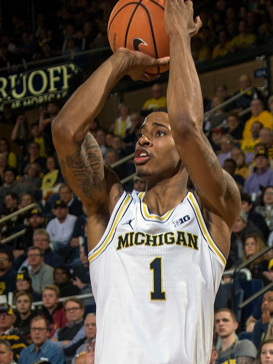 FILE - In this Jan. 9, 2018, file photo, Michigan guard Charles Matthews (1) attempts a three point basket in the second half of an NCAA college basketball game against Purdue at Crisler Center in Ann Arbor, Mich. No. 4 Michigan State and Michigan will meet Saturday in the rivals' only scheduled matchup and it shapes up to be an intriguing game. (AP Photo/Tony Ding, File)