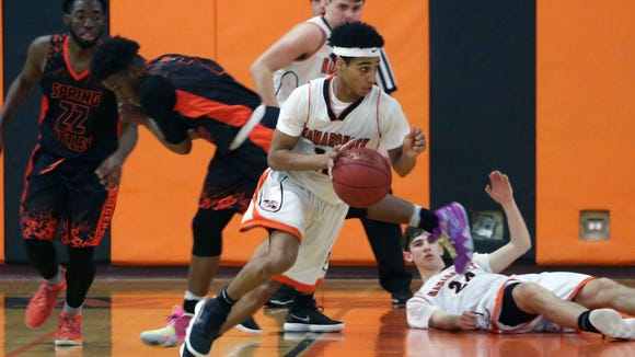 Mamaroneck's Isiah Thomas (12) comes away with a steal against Spring Valley during Section 1 boys basketball playoff action at Mamaroneck High School Feb. 23, 2018. Mamaroneck won the game 49-42.