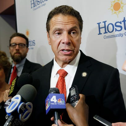 New York Governor Andrew Cuomo speaks to reporters