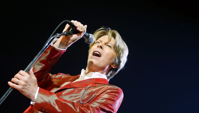 David Bowie performs during a concert at the Zenith in Paris in 2002.