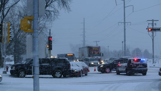 Police respond to a crash at the intersection of South Business Drive and Washington Avenue Feb. 8 in Sheboygan.