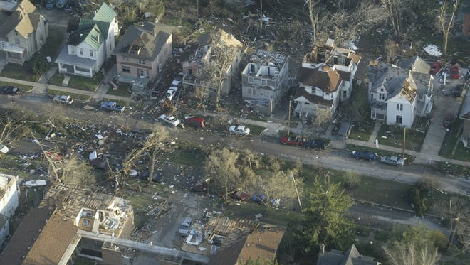 Damage is seen along Iowa Avenue in Iowa City after a tornado tore through the neighborhood on April 13, 2006.