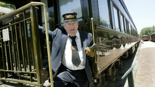 Indiana Transportation Museum volunteer Pete McConnachie (cq) of Indianapolis,  works as a conductor to greet passengers when they ride the trains at the Indianapolis Transportation Museum in Forest Park in Noblesville. This summer and into fall, the museum's trains will take people to smaller towns in northern Hamilton County, leaving from downtown Noblesville with stops in  Cicero, Arcadia and Atlanta. Riders can leave the train and explore these towns.  (Joe Vitti/Indianapolis Star)
