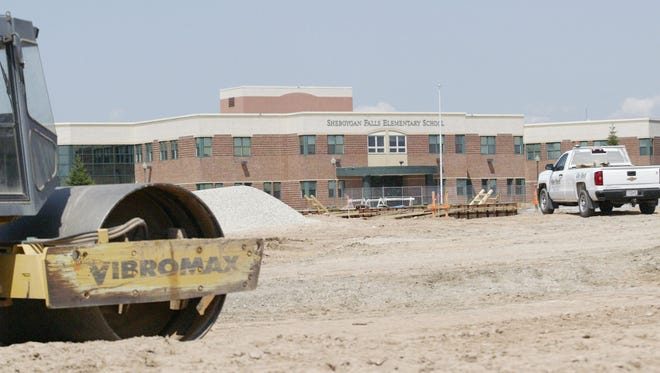 Construction is underway July 11, 2017, for a new middle school in Sheboygan Falls, which will be adjacent to the district's existing elementary school. Voters in November approved a referendum authorizing the construction project.