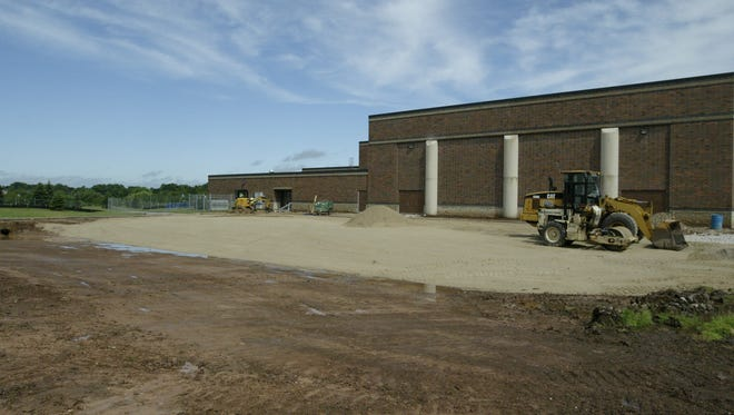 Work is ongoing July 12, 2017, to build a new school auditorium in Howards Grove.