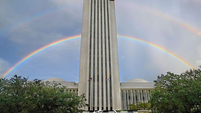 A double rainbow forms behind the Florida Capitol building