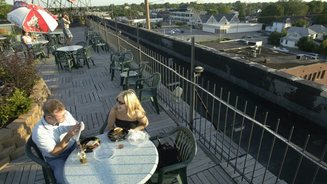 Grant Detrick and Marjie Biel enjoy Rooftop Garden Cocktail Lounge atop  Fountain Square Theatre Building. The bar is only one of a couple of rooftop bars in Indianapolis, but another is due on Mass Ave. and one more in Carmel in 2018.