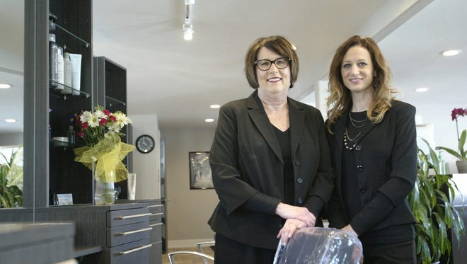 Barb Gruenke, left, and Tannie Holschbach stand together inside Mustard Seed Hair Company, the hair salon the pair opened recently in Sheboygan.