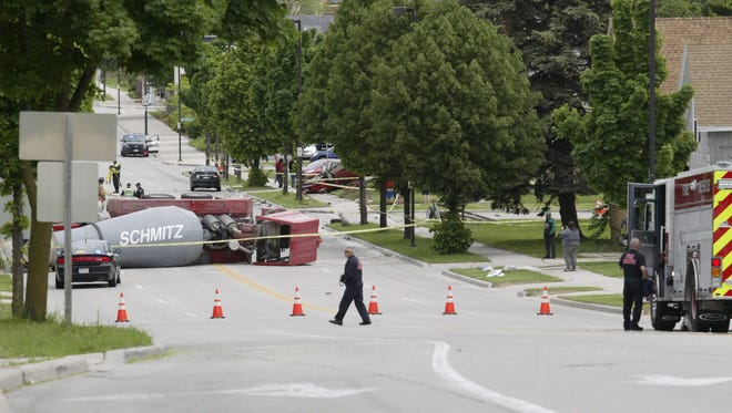 A cement mixer truck was on its side after it was involved in a multi-vehicle crash Friday, June 1, 2018, in Sheboygan.