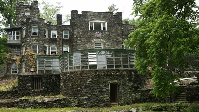 This May 5, 2004 photo shows the Tiedemann Castle in Greenwood Lake, owned by former New York Yankees star Derek Jeter. The property features a 6-foot (1.8-meter) stone wall, a turret, an infinity pool, a lagoon and a small Statue of Liberty replica. It is on the market for $14.75 million.