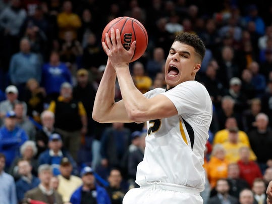 FILE - In this March 8, 2018, file photo, Missouri's Michael Porter Jr. pulls down a rebound during the second half in an NCAA college basketball game against Georgia at the Southeastern Conference tournament, in St. Louis. The Missouri Tigers could be a very dangerous No. 8 seed in the West Region. How dangerous all depends on how quickly freshman Michael Porter Jr. can shake off the rust of missing all but 25 minutes of game time because of an injured back. (AP Photo/Jeff Roberson, File)