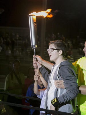 Britton Shipp was the official torch bearer for the opening of the 2015 Utah Summer Games in Cedar City on Thursday.
