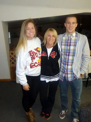 Louisville mother Karen Johnson with her daughter, Natalie, 21, and son Nathan, 24, during a Dec. 26 photo taken at an Ohio rehabilitation center, where Nathan is still being treated for an addiction to heroin and other opioids.