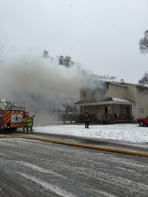 Rescue crews are at the scene of a house fire at 11th and Cedar streets in Port Huron.