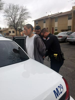 This photo provided by the Albuquerque Police Department shows Lionel Clah being taken into custody by Albuquerque police Saturday, March 12, 2016, in Albuquerque, N.M. Clah was the second of two New Mexico convicts who escaped from a fortified prison transport van Wednesday.