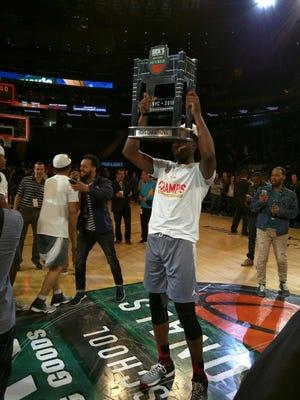 Mario Kegler hoists the trophy at Madison Square Garden.