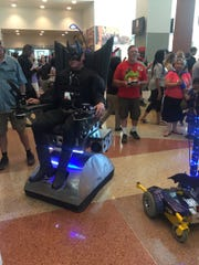 Lance Greathouse brought his custom wheelchair and