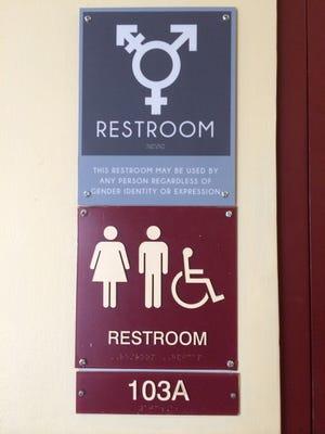 A sign designating an All Gender restroom on campus.