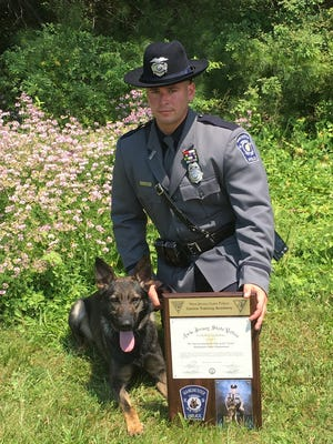 Ptl. Steven Wendruff and his canine partner Lynk.