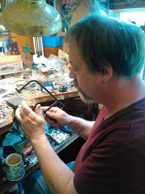"""Bill Thorpe is a metal smith in Johnson City. """"It's a magical medium,"""" he says."""
