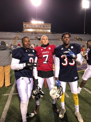 From left, UNC commits Antwuan Branch, Kayne Roberts, and Caleb Rozar pose for a photo during this year's East vs. West All-Star teams