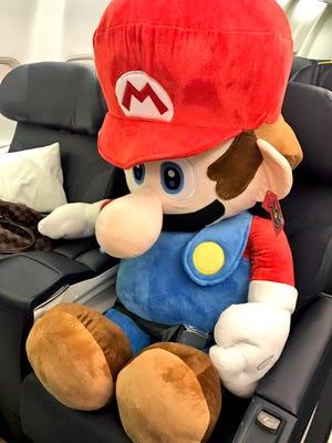 Predators players won a stuffed Mario doll during a flight delay Friday.