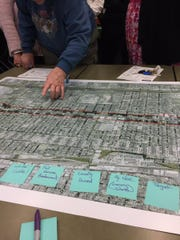 Community members look at a map of the Kearney Street