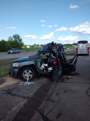 The totaled remains of a 2004 Mitsubishi Endeavor driven by Devin Cyr Saturday. Cyr died Sunday from injuries sustained from the accident.