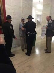 Capitol Police remove journalist Dan Heyman on May 9, 2017, in Charleston, W.Va.