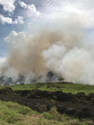 A brush fire is seen Thursday, June 1, 2017, in western St. Lucie County. County officials said they plan to let a countywide burn ban expire Friday, June 9, after the area saw a week of heavy rain.