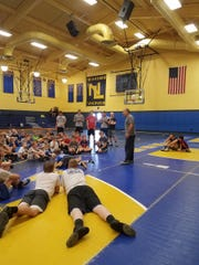 Three-time former NCAA champion Ricky Bonomo addressed youngsters at Northern Lebanon's Wreck Room youth wrestling camp on Thursday.