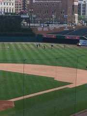 The Comerica Park grounds crew works on the outfield