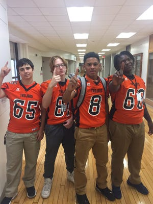 Waterloo East players pose before Friday's game.