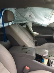 Lightning struck a car in Titusville injuring the driver and a nearby motorcyclist.