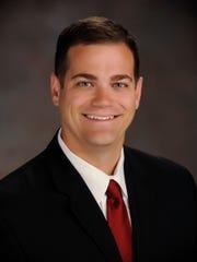 Dr. Brandon E. Newell