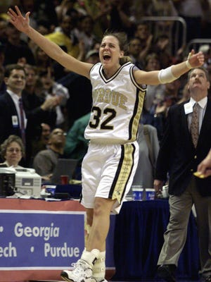 Katie Douglas celebrates Purdue's 62-45 win over Duke in the NCAA women's basketball national championship game at the San Jose Arena in San Jose, California.