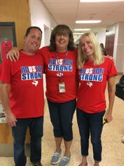 "Lenape High School teachers Tony Guerrera (left), Dani Brining and Jen Guerrera wear their ""Houston Strong"" T-shirts at school recently. The school organized a fundraiser to assist hurricane victims and people who donated $10 or more for the effort received T-shirts, which were worn at school on Sept. 15. Staff members were also able to wear denim on that date as well."
