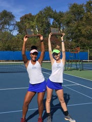 Millburn junior Jessica Atwater (left) and senior Sara Jacobs pose with their state doubles championships.