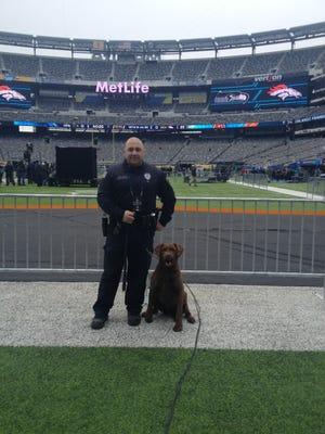 Millville police Officer John Butschky and partner, K9 Hannah at Super Bowl 48.