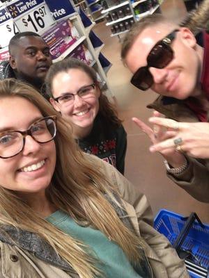 Jaycie Pohlman and Katie Jenkins met Macklemore at the Vermillion Walmart.