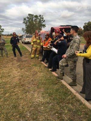 Authorities receive a briefing prior to entering the hazmat situation of a suspicious package received at the Air National Guard station in Point Mugu.