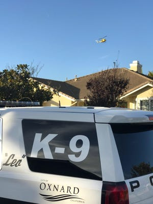 A police helicopter and Oxnard K-9 vehicle on scene during the search for a suspect involved in a stolen vehicle pursuit out of Ventura on Wednesday.