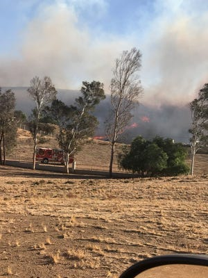 A vegetation fire broke out Thursday afternoon in an unincorporated county area of Murrieta, burning at 220 acres with 0% contained,prompting officials to order evacuations for several streets.