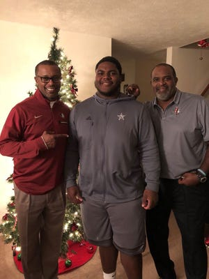 FSU coach Willie Taggart and defensive tackles coach Odell Haggins visits with four-star defensive tackle Robert Cooper.