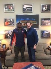 Four-star 2018 DE prospect Kayode Oladele poses for a picture with Auburn head coach Gus Malzahn during his official visit to Auburn this weekend.