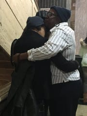 Family members console each other after the sentencing of Javondus Beasley for one count of capital murder and two counts of second-degree murder.