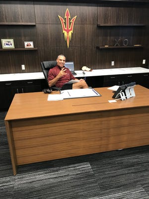 New Arizona State throws up the pitchfork behind his desk in a photo posted on Twitter.