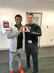 Recruit Steve Stephens (left), a defensive back, is part of Oregon coach Mario Cristobal's (right) first recruiting class with the Ducks.